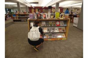 Student Checking Out Display
