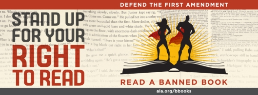 Superheroes stand on a book fighting for their right to read