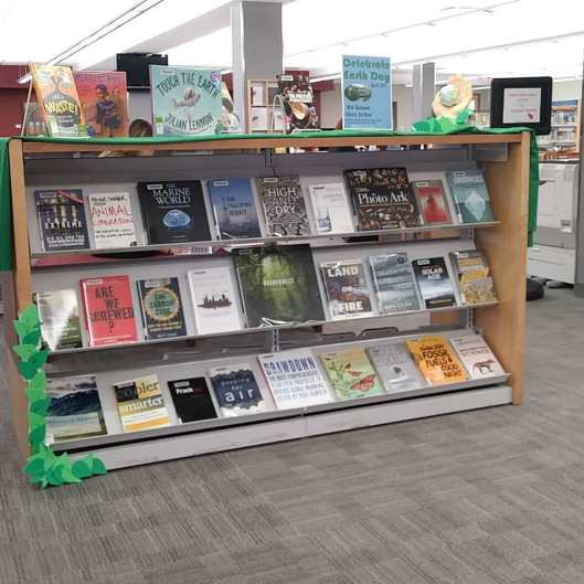 A decorate Display covered with environmental books
