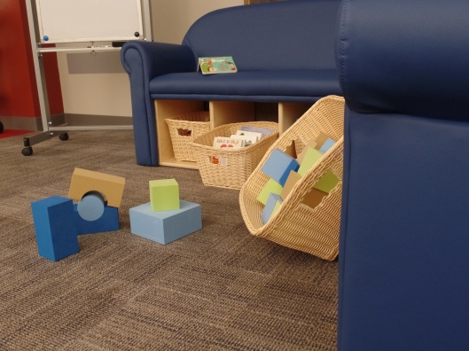 Blue furniture with baskets of blocks and board books
